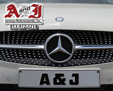 Photo of a Mercedes grill with A&J license plate and Phone 1-813-977-1214