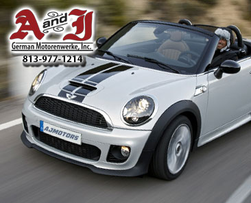 White & Blue Racing Stripe Mini Cooper Driving with AJ Motors in License Plate with A&J Logo with Phone 1-813-977-1214
